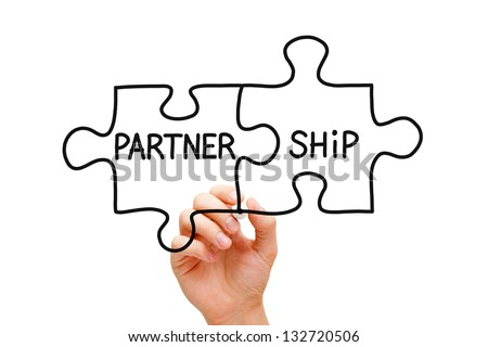 Hand drawing Partnership Puzzle Concept with black marker on transparent wipe board. - stock photo