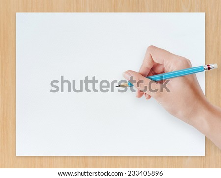 Hand drawing pencil on white paper sheet with wooden texture background. - stock photo