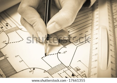 Hand drawing road plan. Sepia tone. Shallow DOF. - stock photo