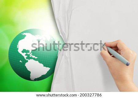 hand drawing rope to open crumpled paper to show 3d earth globe against blue and green nature background  - stock photo