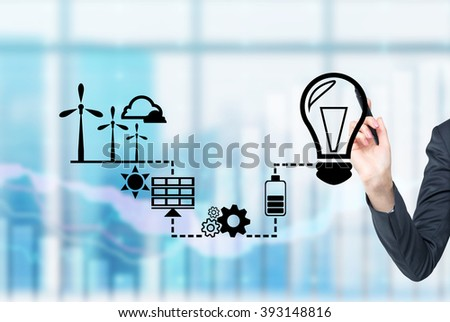 Hand drawing symbols of alternative energy sources. Blurred office background. Concept of clean environment. - stock photo