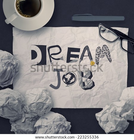hand drawn design words DREAM JOB on crumpled paper background as concept  - stock photo