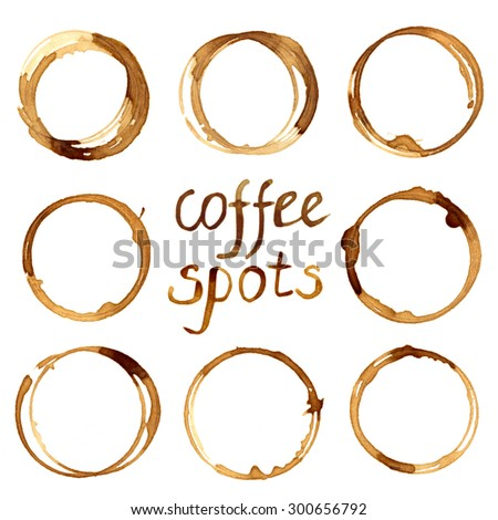 Hand drawn illustration of coffee circle stains. Set of brown spots drawn with real coffee on white background. Collection of design elements. Coffee theme.