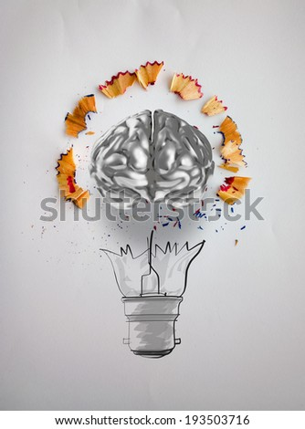 hand drawn light bulb with pencil saw dust and 3d brain icon on paper background as creative concept  - stock photo