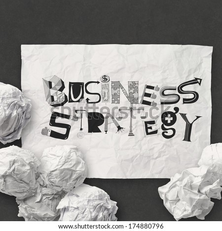 hand drawn on crumpled paper with design word BUSINESS STRATEGY as concept - stock photo