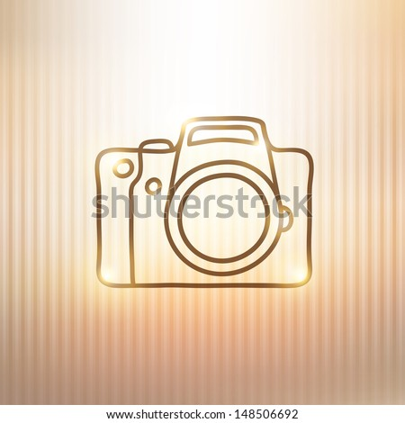hand drawn photo camera on gold background - stock photo