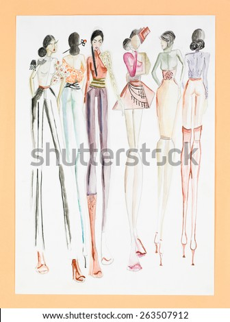 hand drawn sketch of fashion models in colored haute couture designs - stock photo