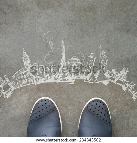 hand drawn traveling around the world on front of business man feet as concept  - stock photo