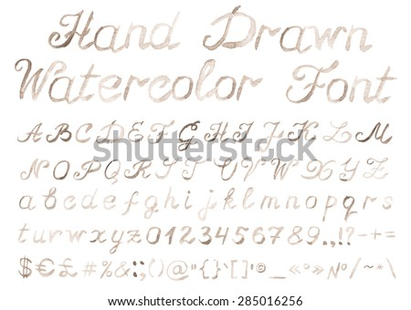 Hand drawn watercolor alphabet. Handwritten sepia font isolated on white background. Contains uppercase and lowercase letters, numbers, punctuation signs and important symbols. Real watercolor texture - stock photo