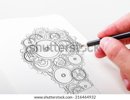 hand drawning lamp gears in a notepad - stock photo