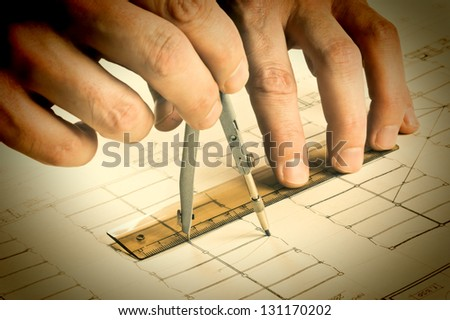 hand draws a pencil on the drawing - stock photo