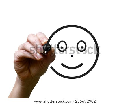Hand draws happy face with black marker on transparent whiteboard - stock photo