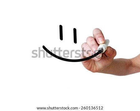 Hand draws smiley with black marker on transparent whiteboard - stock photo