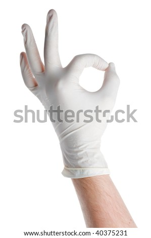 Hand dressed in medical glove showing OK sign isolated on white - stock photo