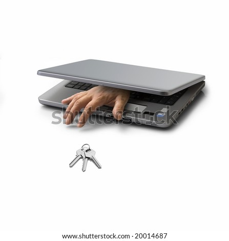 hand emerging from a closed pc laptop trying to steal a key - stock photo