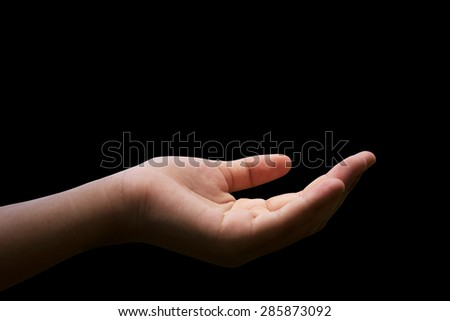 Hand for the opportunity and support on black background. helping misery,wanting to help. Gray tone empty women open hands holding. The concept of aid. Open palms hand gesture.