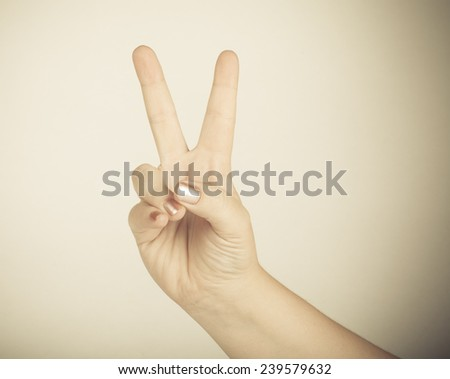 "hand gesture, meaning ""victory"" - stock photo"