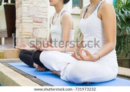 hand gesture woman doing outdoor lotus stock photo