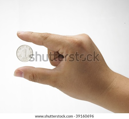 Hand gesture with one Chinese Yuan coin. Concept of development,  fortune, accumulation