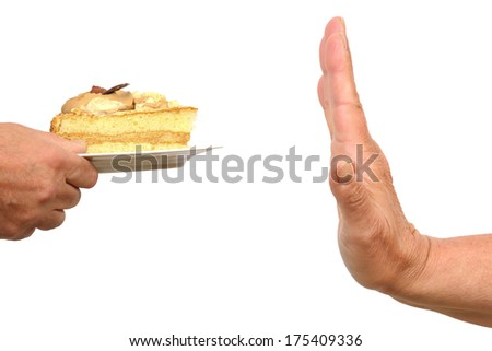 Hand gesturing no to a piece of cake - stock photo