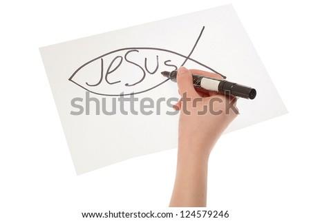 Hand girl drawing a Christian fish symbol - stock photo