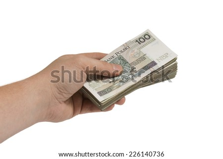 hand giving a bribe, heap of money, corruption, isolated on white - stock photo