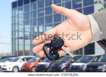 Hand giving a car key. Auto repair service. - stock photo