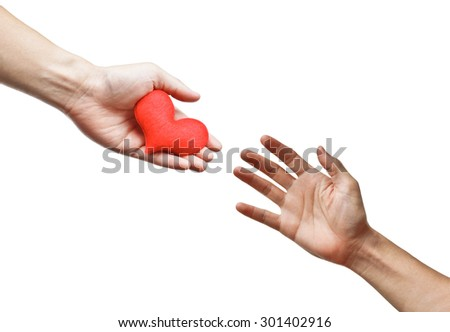 hand giving a red heart to other people - stock photo