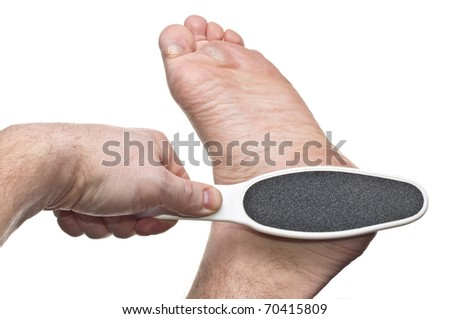 Hand giving heel treatment for callus isolated on white - stock photo