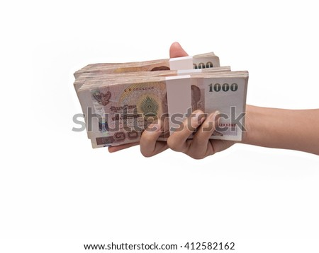 Hand giving Thai banknotes, isolated on white background
