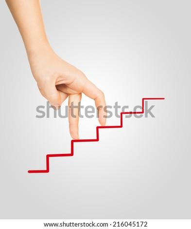 hand goes on to draw a red ladder - stock photo