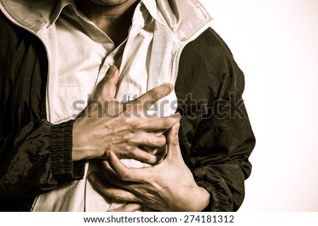 hand grabbing on chest & copy space on right for heart attack or sentimental concept - stock photo