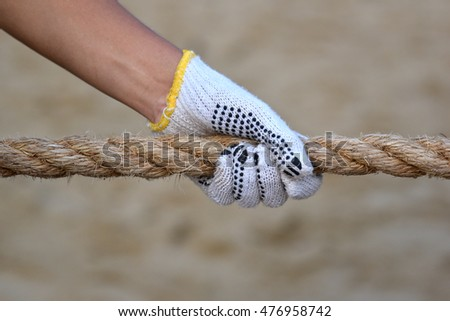 Hand Grabbing On Rope In Tug Of War