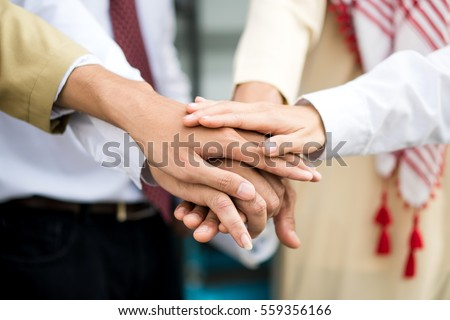 Hand group Teamwork Join Hands Partnership Third party, Arab and Muslim Business clasping hand Concept.