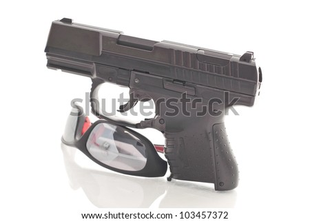 Hand Gun and Safety Glasses