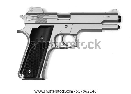Hand gun in silver and black