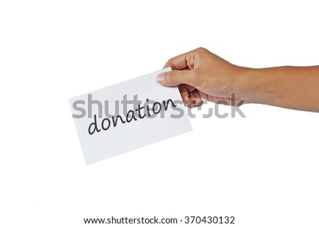 hand handing out a small white envelope. isolated on white background. donation text on the envelope.