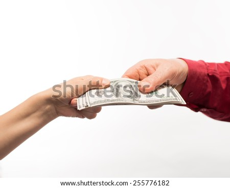 Hand handing over money - stock photo