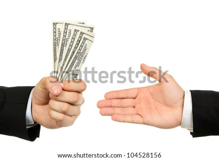 Hand handing over money to another hand isolated on white background - stock photo