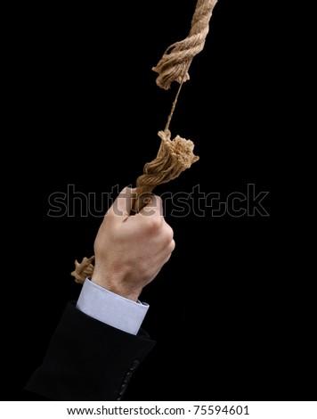 Hand hanged on damaged rope - stock photo