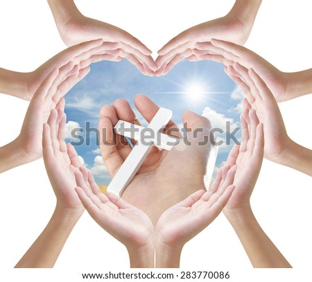 Hand heart shape and hand holding cross - stock photo