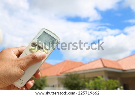 Hand held remote control, direct to cloudy sky