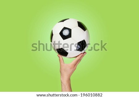 Hand hold ball on color background - stock photo