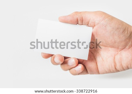 Hand hold blank business card on white background