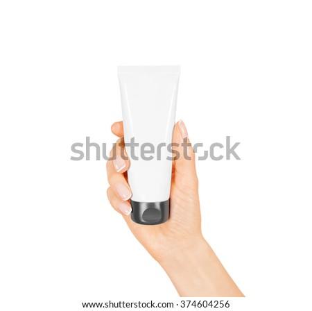 Hand hold blank white tube mock up isolated. Empty cream bottle mockup template holding in hands. Tube design presentation. Skin care mockup. Skincare tube design, - stock photo
