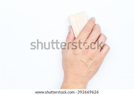 hand hold board eraser isolated on white background. - stock photo