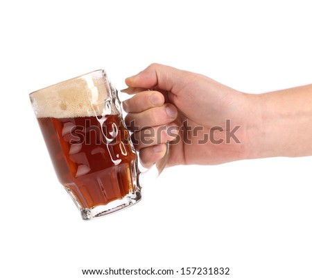 Hand hold brown beer in glass isolated on white - stock photo
