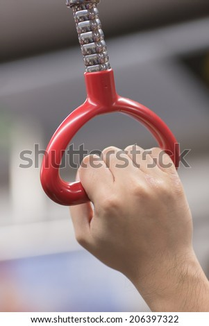 Hand hold bus or train handle bar - stock photo
