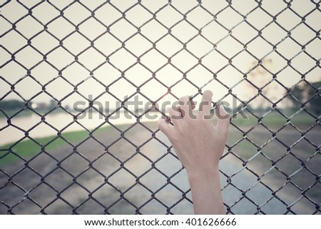 hand hold cage of hopeful.hope concept