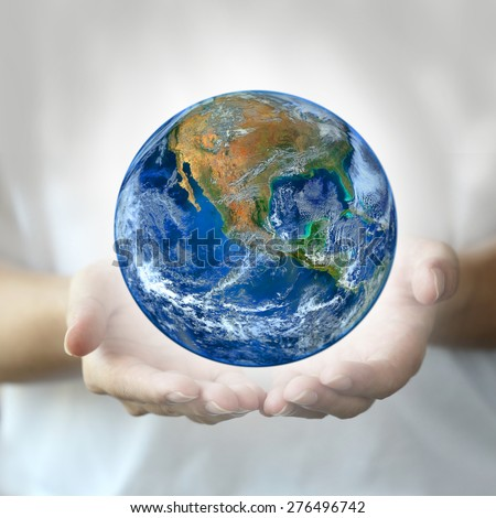 hand hold earth.,   Planet world. Elements of this image furnished by NASA - stock photo